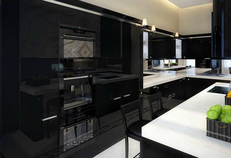 Σε αυτή την κουζίνα κυριαρχεί το μαύρο χρώμα τόσο στο μεγαλύτερο μέρος του χώρου, όσο και στις συσκευές