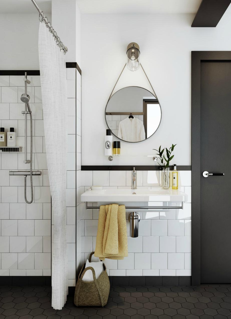 ΟΙ κίτρινες πινελιές δίνουν λίγο χρώμα και ζωντάνια σε αυτό το μπάνιο.