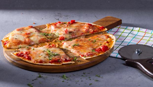 Πίτσα με Τορτίγιες από τον Άκη Πετρετζίκη